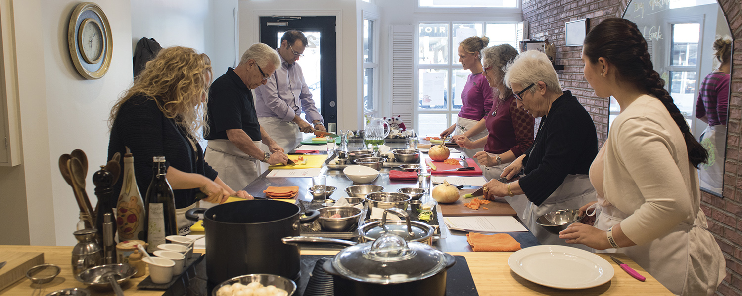 A group at C'est Bon Cooking in Ottawa prepares its own Canadian cuisine