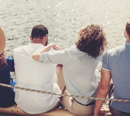 Group socializing on boat deck