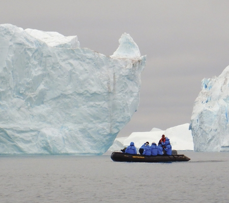 Zodiac boat among the icebergs